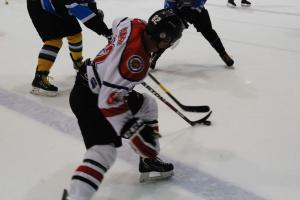 Ceptors' captain Jake Adamsons fights for the puck on Friday.