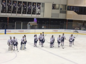The many Ice players still standing at the end of the game salute the crowd.