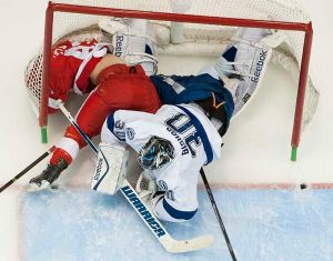 Darren Helm shows standard Red Wing desperation, crashing the Tampa Bay net. Pic: Detroit News