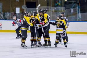 My boy, Big Cat, is mobbed by Cherokees after scoring. He got a hat-trick last night and is a pure goal-scorer when fit and firing. Pic: Luke Milkovic.