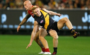 Tiger Nathan Drummond buckles his knee in his first game. Pic AFL Media