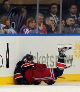 This is NOT how you want to hit the boards. Somehow, Ranger Brad Richards came out of this okay.  Pic: Getty.