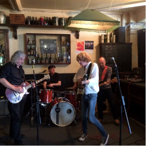 The Large No. 12s, at the Labour In Vain, with Tiger Mick on guitar (in the back, far right) and a lead singer with a working back.