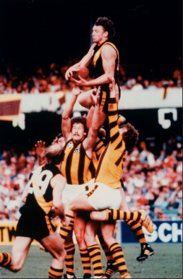 Michael 'Disco' Roach (#8) taking his greatest mark ever, with Kevin 'Hungry' Bartlett (#29) roving the pack. Once Tiger champions, now Lotto numbers.